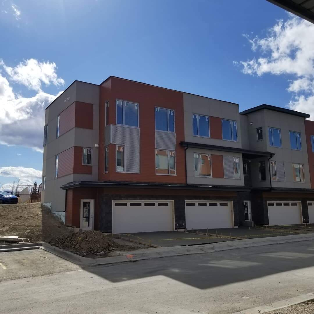 Hardie panels and metal siding on townhouses in Calgary