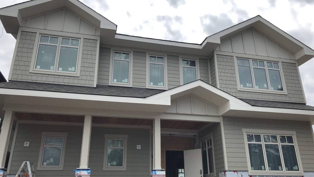 Hardie siding and shingles installation project on a single house